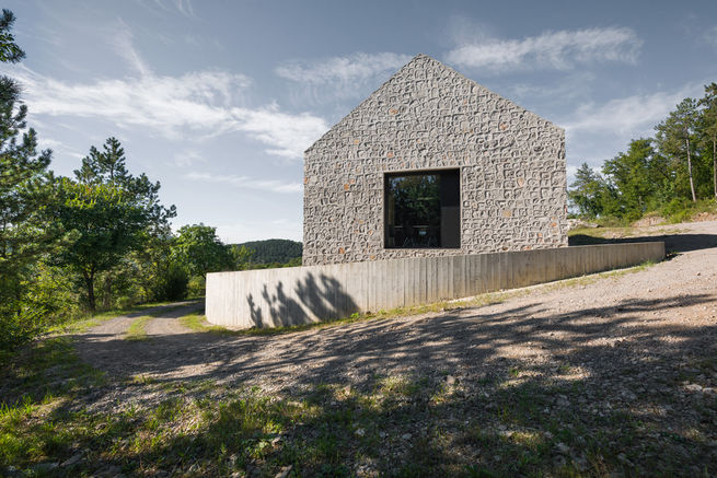 Stone house limestone and concrete exterior in Karst
