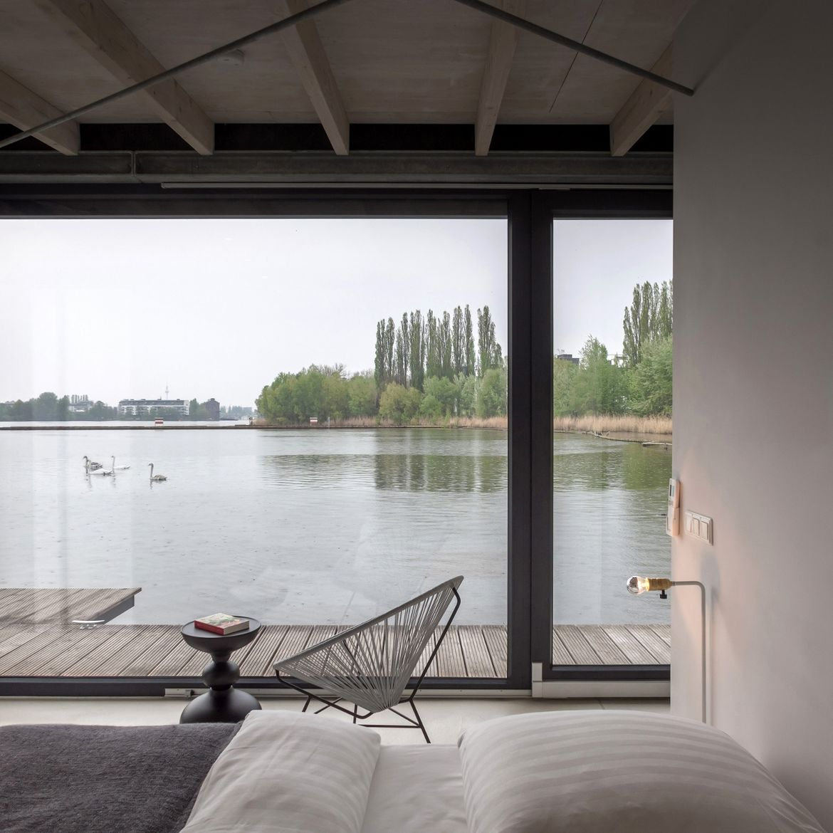 Floating house boat in Berlin with bedroom overlooking the water