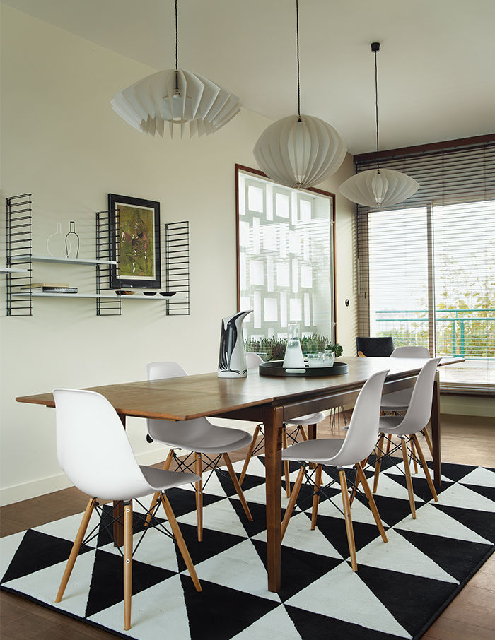 Dining room with IKEA geometric rug and pendant lights