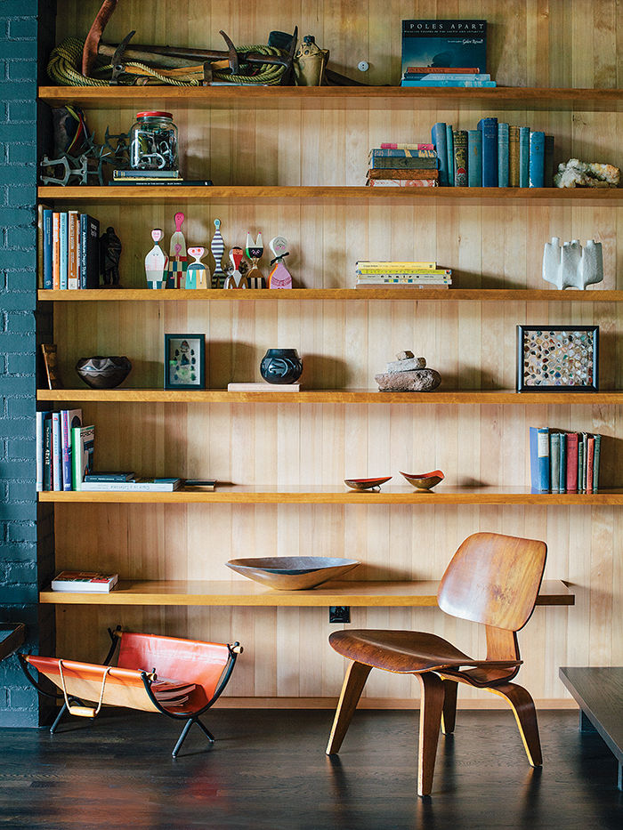 Eames Molded Plywood Lounge Chair and built-in shelving in a midcentury Portland home