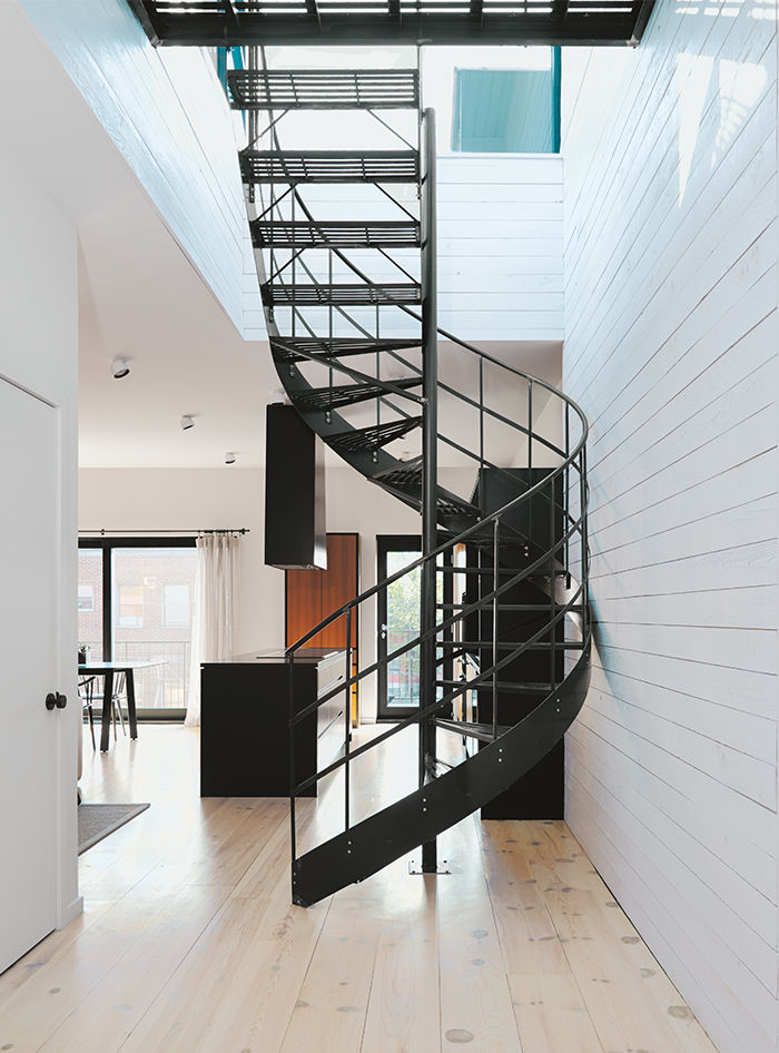Montreal apartment with wrought-iron spiral staircase leading to rooftop
