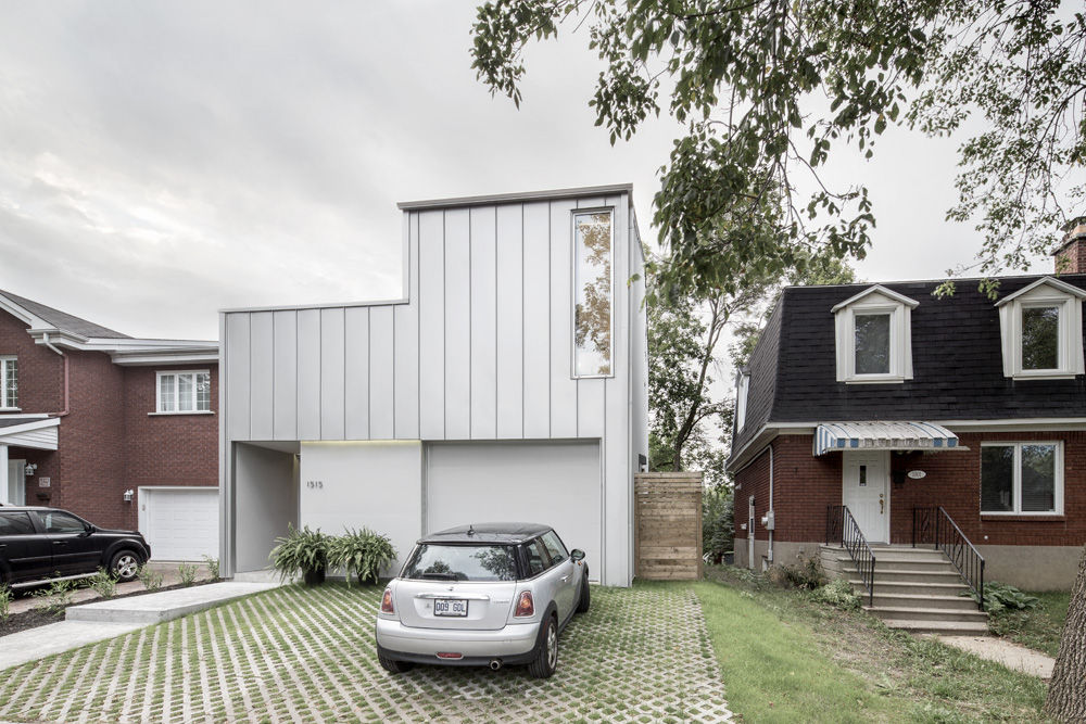 modern house in montreal with metal facade and permeable pavers