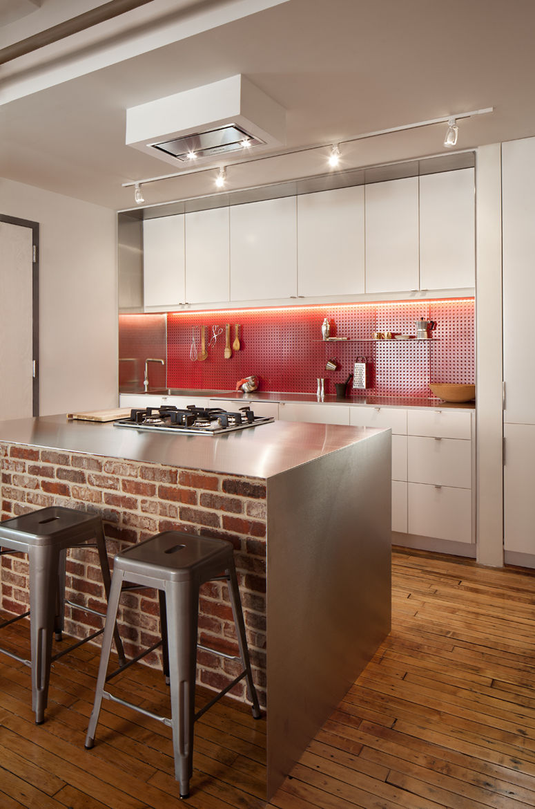 Remodeled Boston kitchen with stainless steel and brick island