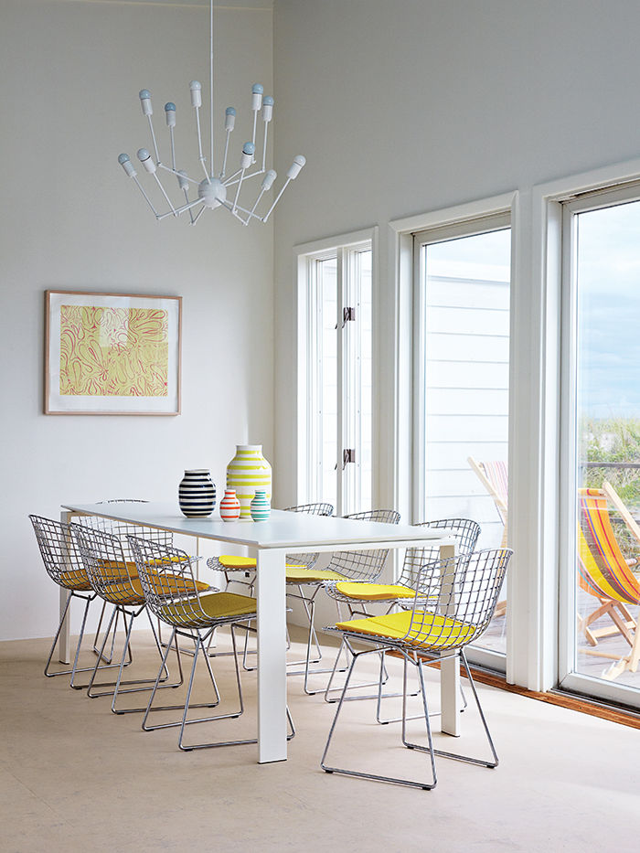 Fire Island dining room with Knoll table, Autoban chandelier, and Bertoia wire chairs