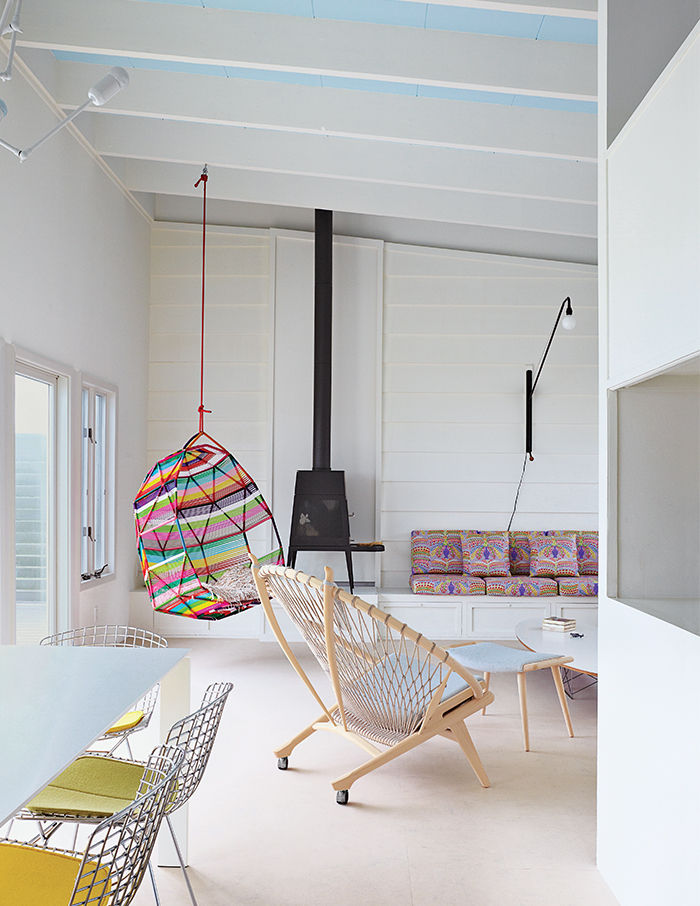 Fire Island living area with a PP130 Circle Chair by Hans Wegner and a wood-burning stove