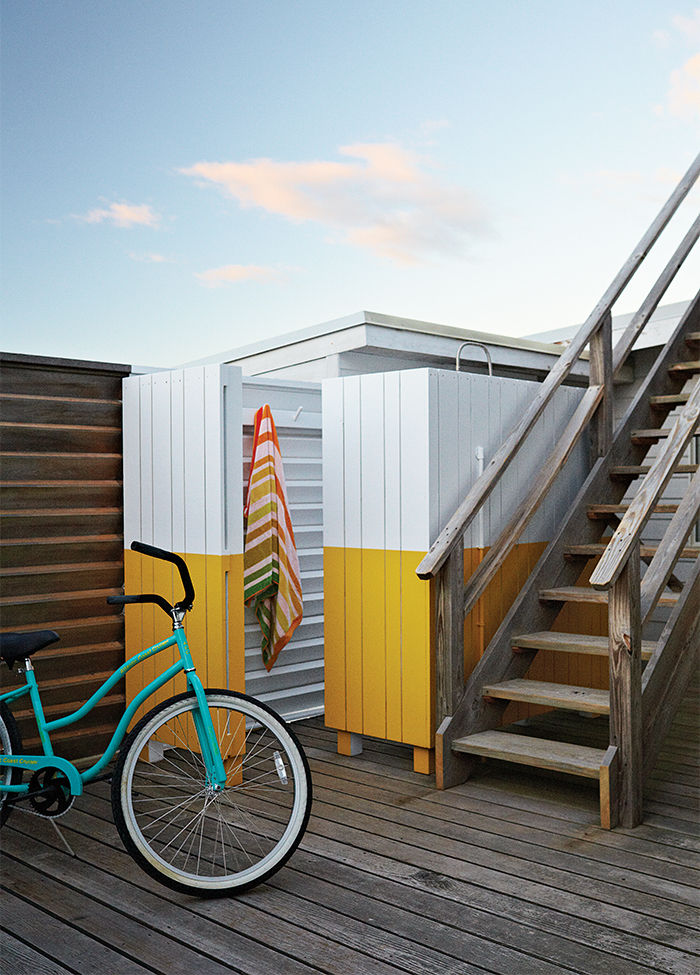 Fire Island outdoor shower with yellow and white wood screen