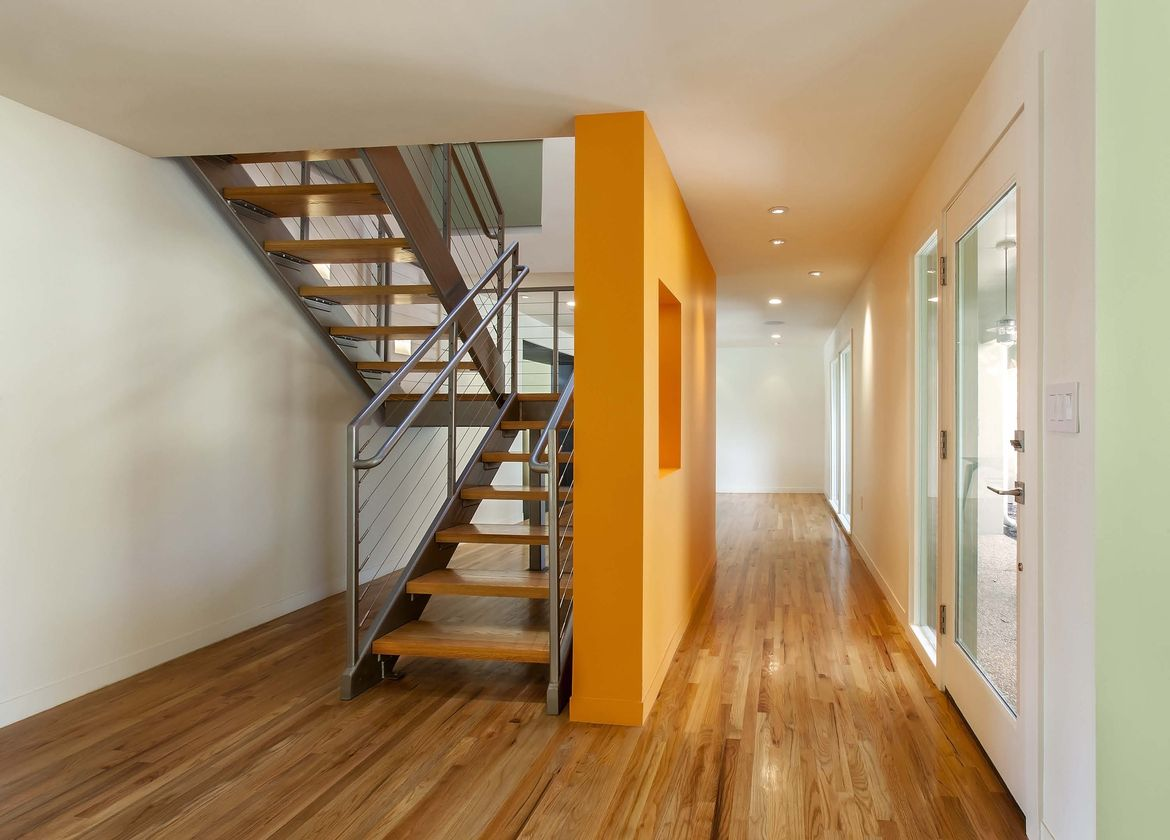 Entry foyer and staircase after renovation of Highland Road house