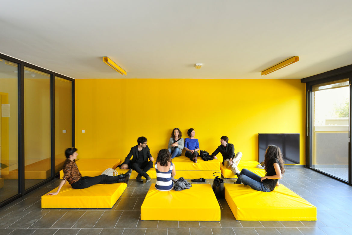 Brick neighborhood in Slovenia with yellow common room