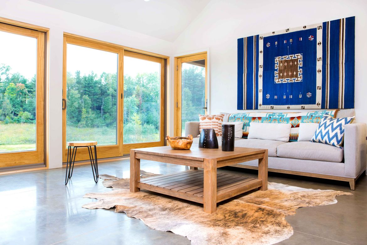 Off the grid retreat with large windows in the living room