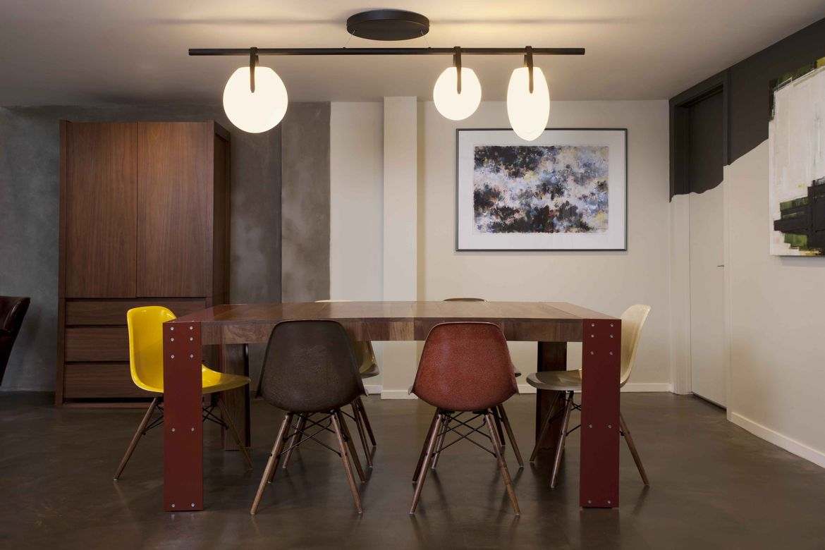 San Francisco dining room with chandelier and Eames shell chairs