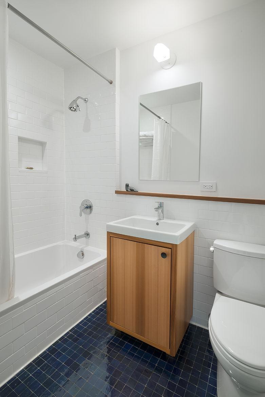 Upper East Side bathroom renovation with navy floor tiles