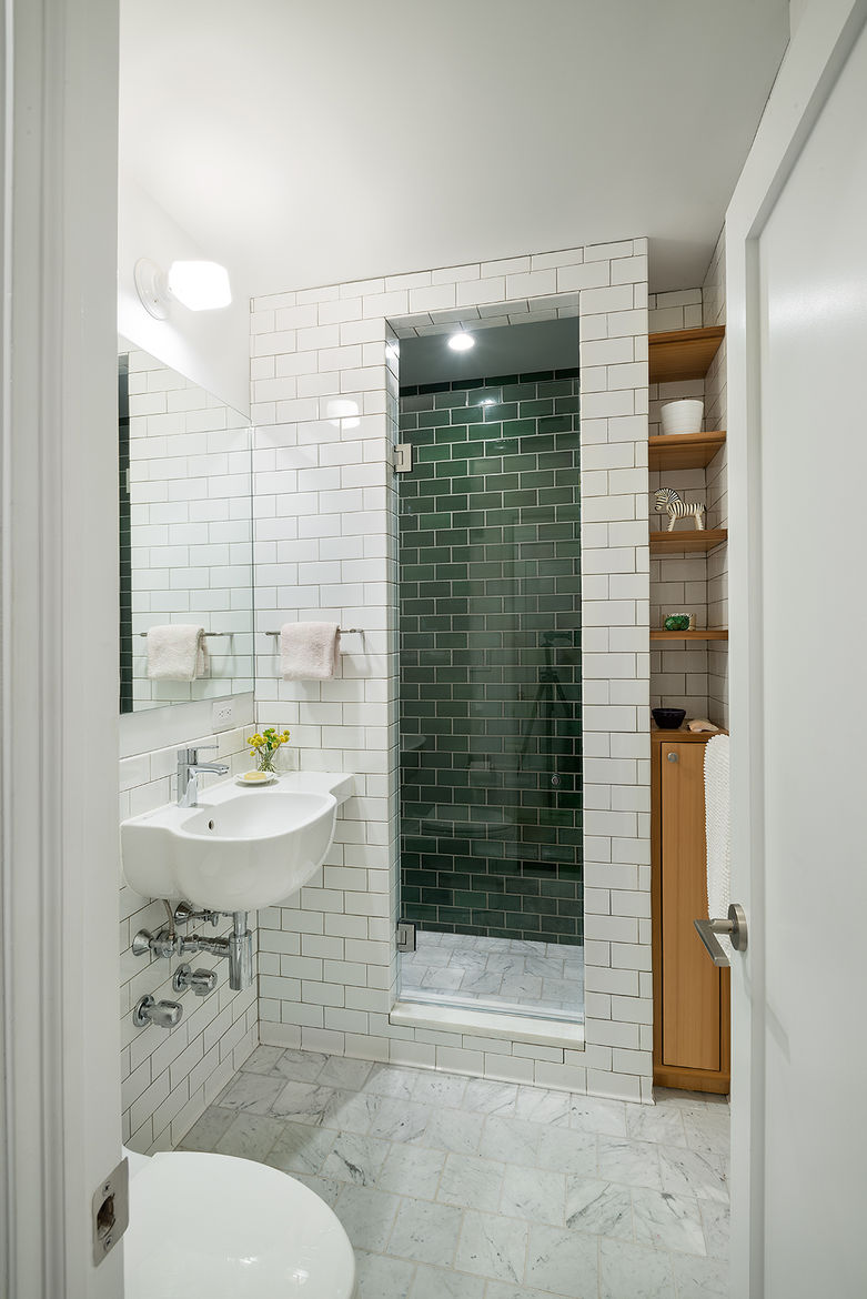 Upper East Side bathroom renovation with mixture of tiles and marble floors