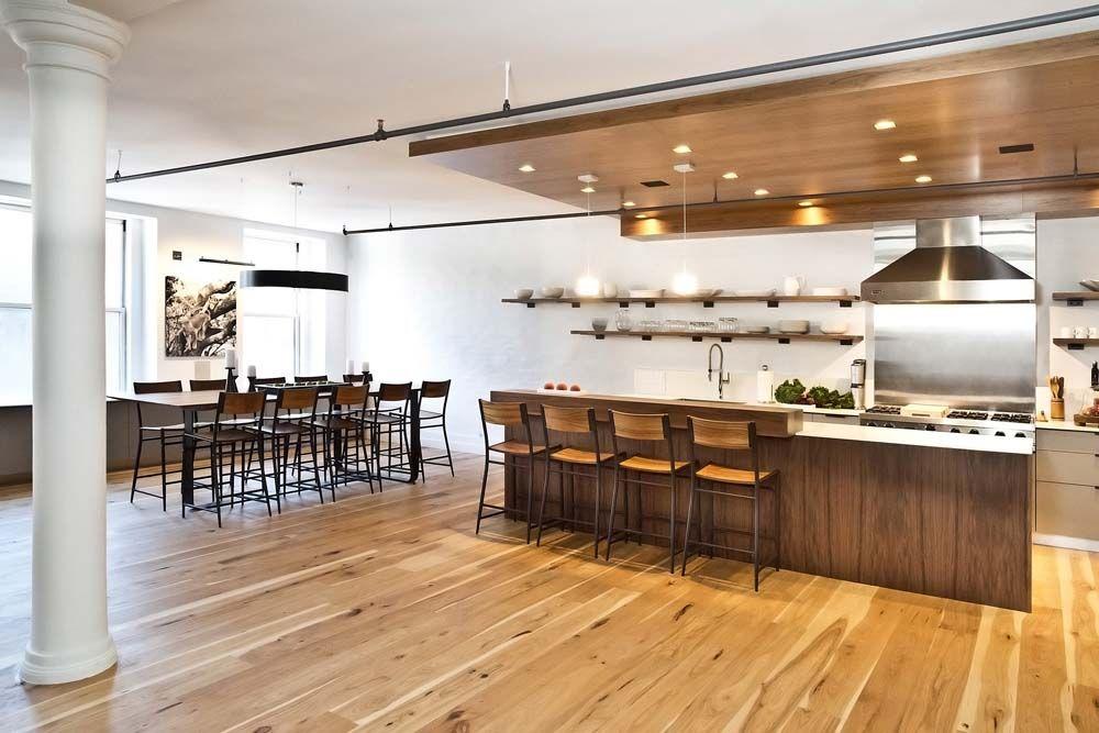 Flatiron loft with walnut drop ceiling and hickory flooring