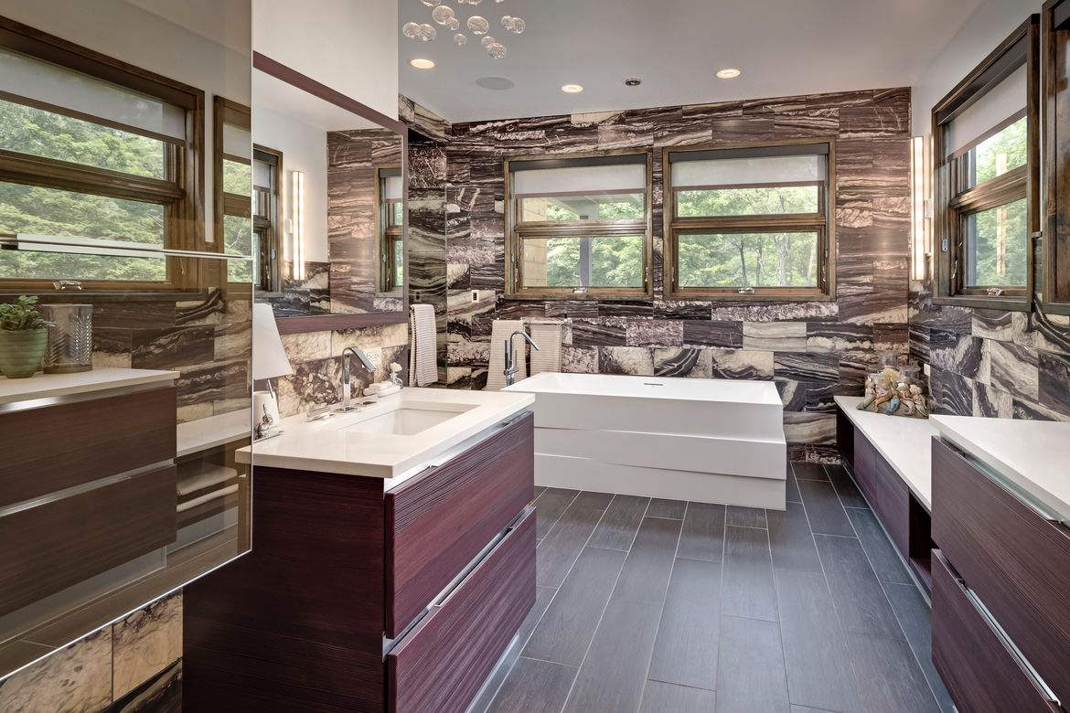 The marble bathroom of a private retreat in Illinois