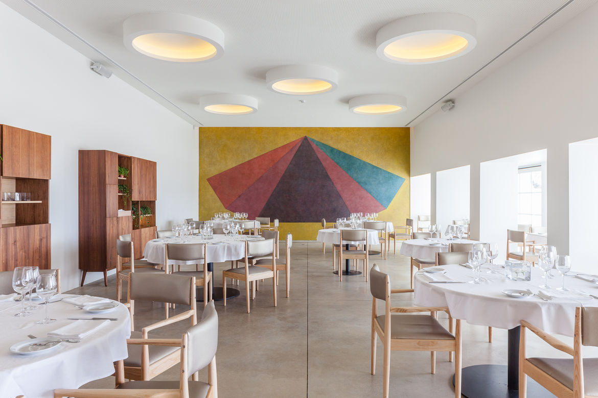 Dining room in a Lisbon restaurant with a Sol LeWitt mural