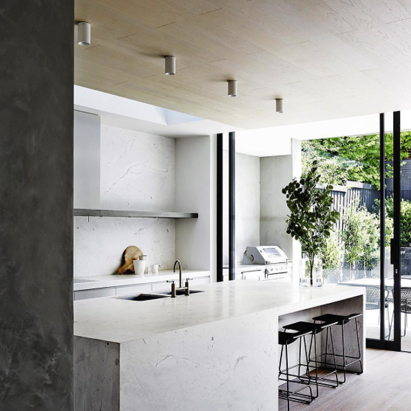 Minimalist kitchen by Mim Design Studio with an indoor/outdoor divide