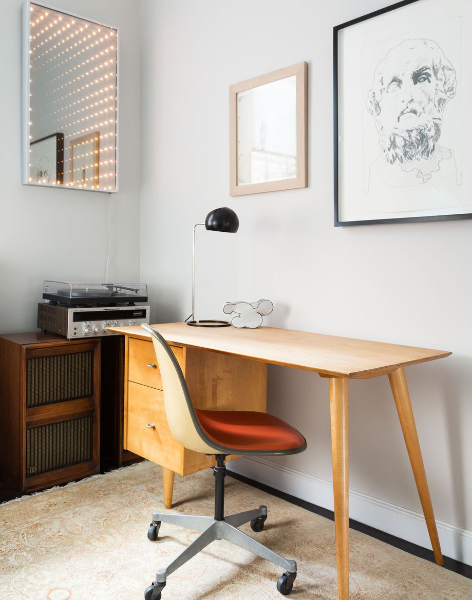Office with midcentury furniture in a West Village apartment