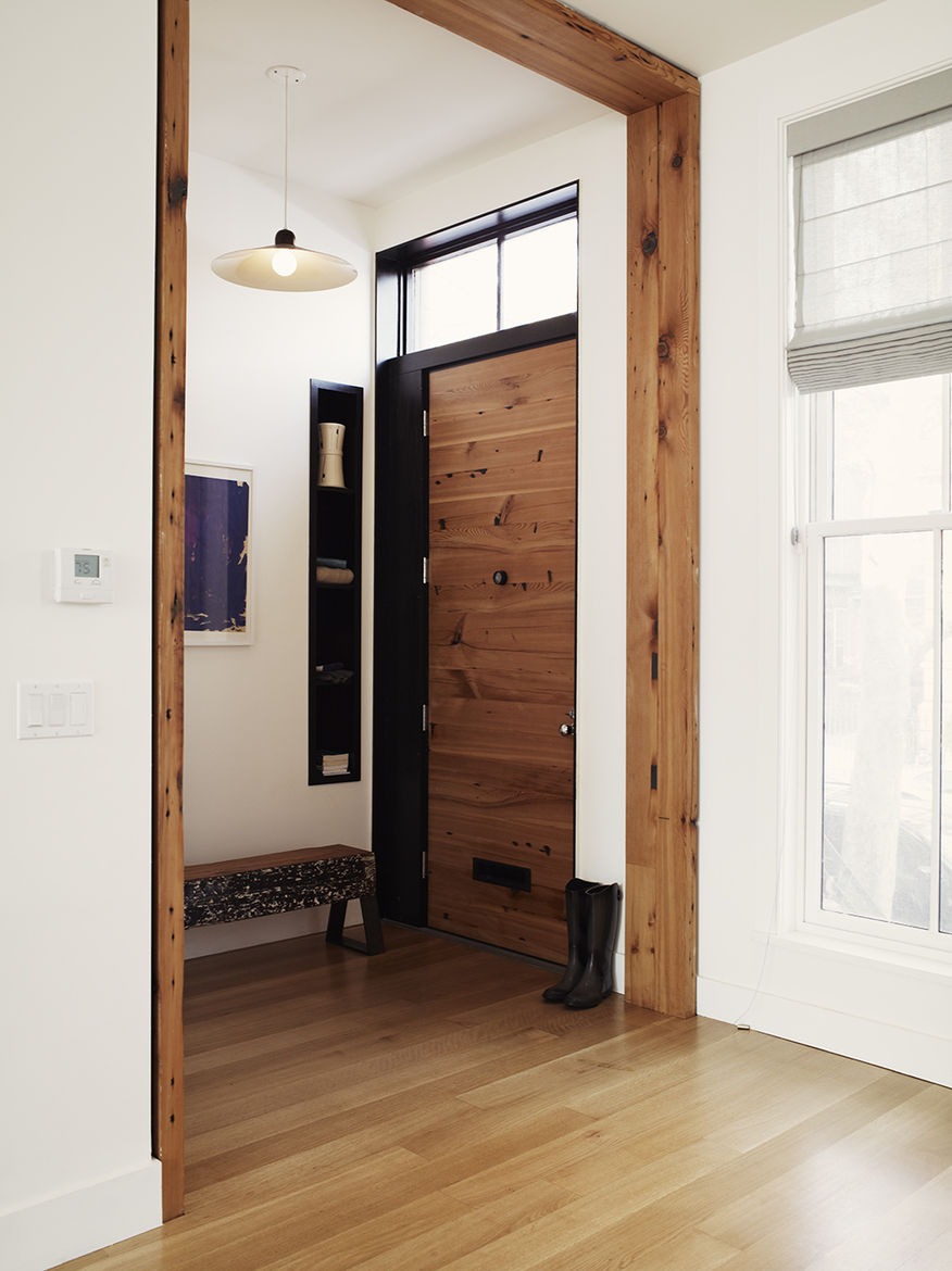 Salvaged wood defines the entryway to a Brooklyn home