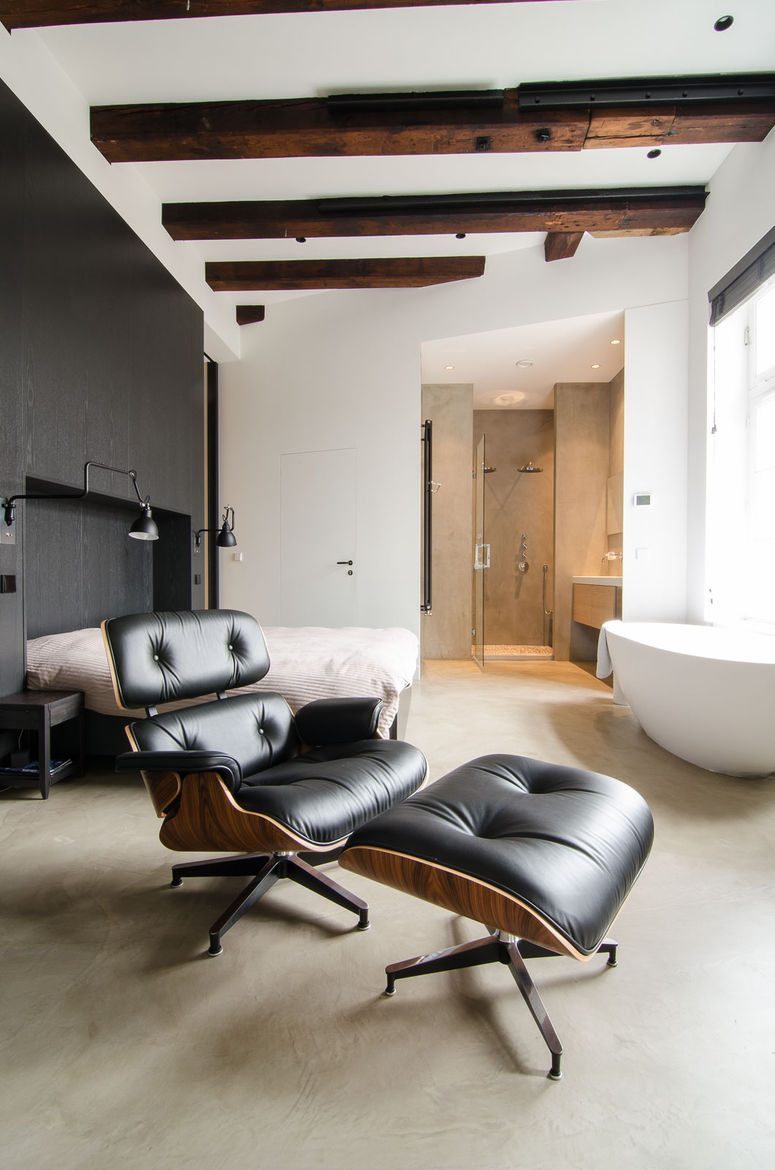 Loft bedroom with a freestanding tub.