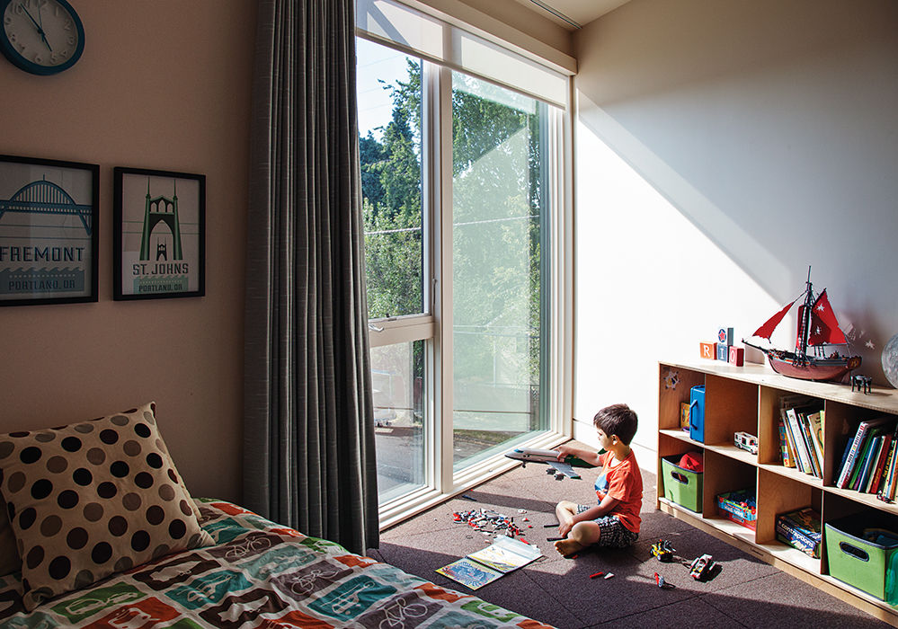 Modern prefab modular and triangular home by HOMB in Portland children's bedroom with floor to ceiling windows with solar shades