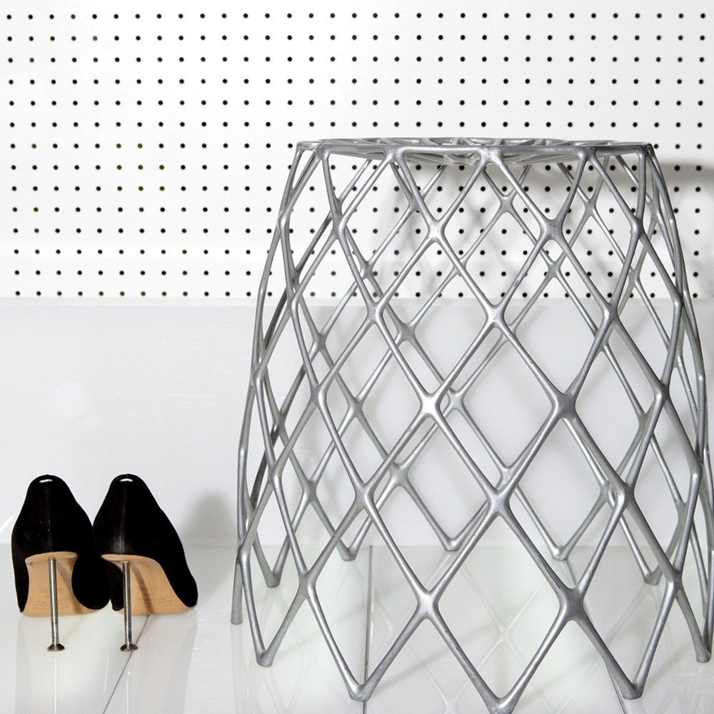Sculptural stool made from recycled aluminum