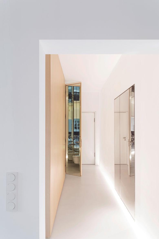 Modern hallway with a mirrored coat closet