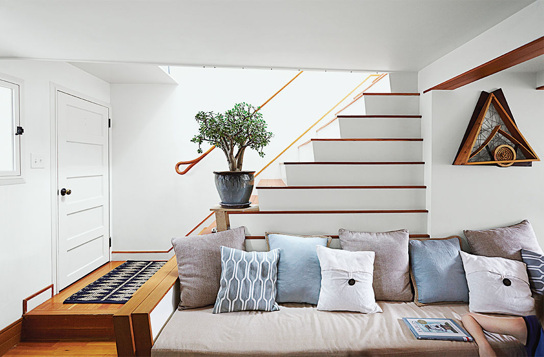 Boston pops renovation small space living room stairs sofa.