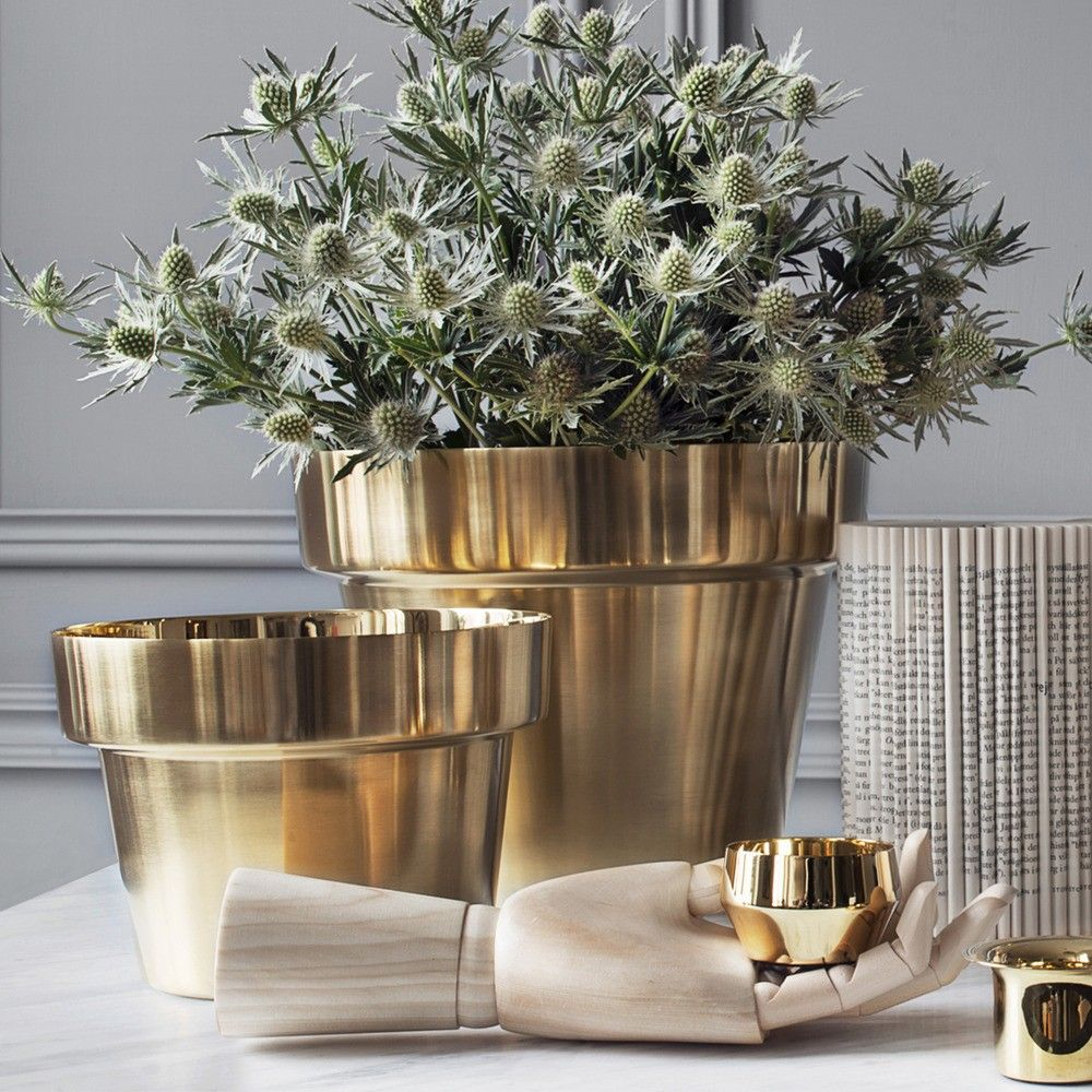 Sophisticated brass flower pot inspired by traditional terracotta pots