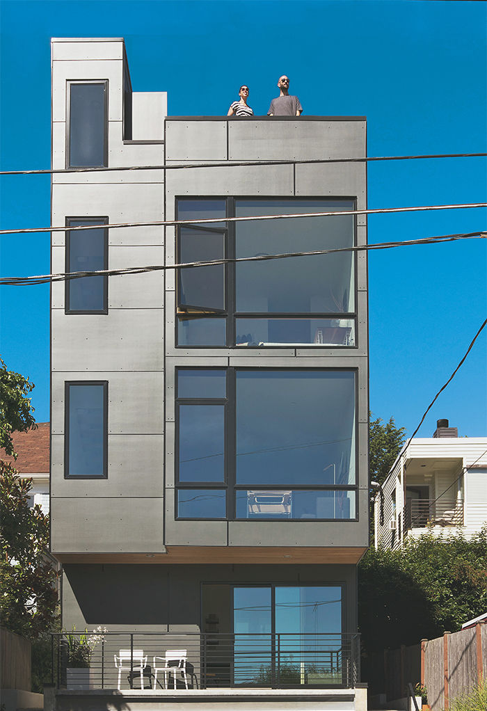 Modern multifamily home in Seattle with cement fiberboard rear facade