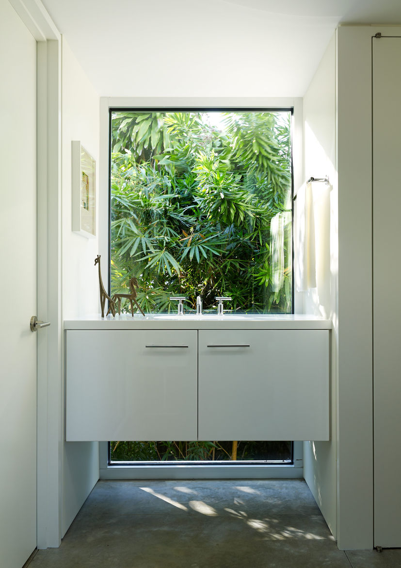 Modern Florida seaside home with kohler fixtures and corian coutertop in the bathroom