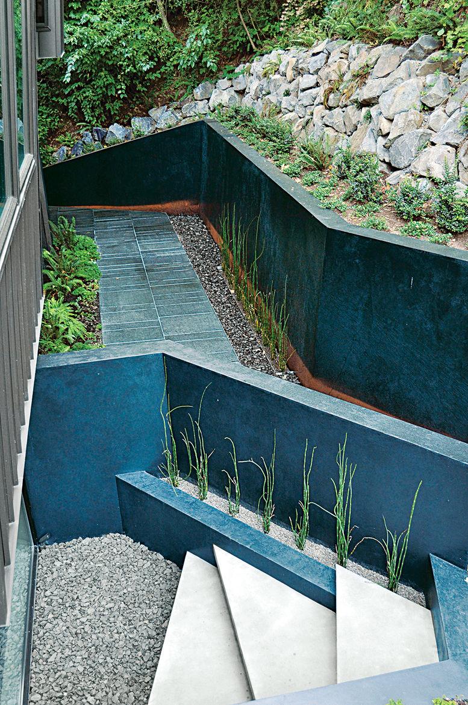 modern landscaping garden pacific northwest concrete retaining wall steel walkway