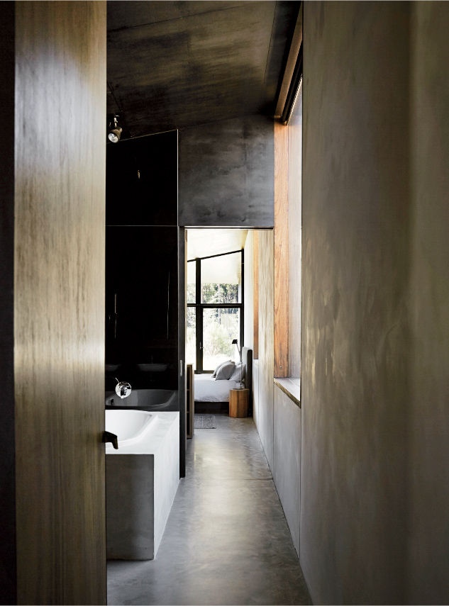 Timber ceiling and concrete floors in a house designed by Kerstin Thompson Architects.