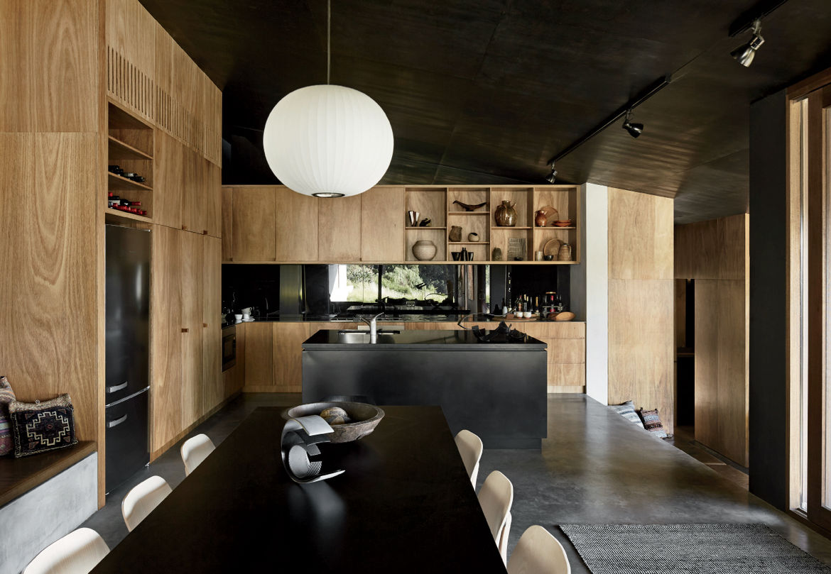 Oxidized steel kitchen island and blackbutt cabinets in home designed by Kirsten Thompson Architects.