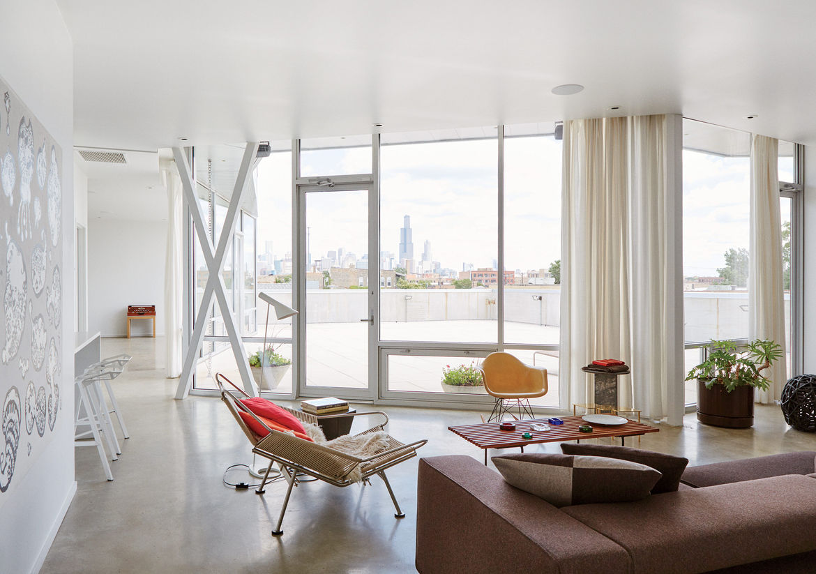Modern prefab Chicago live/work space by UrbanLab with chicago tempered glass windows, tubelite frames, and concrete flooring in the living area