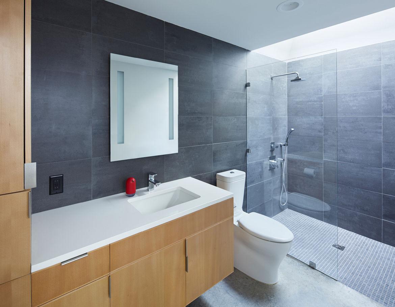 Carrboro House bathroom with custom beech vanity.