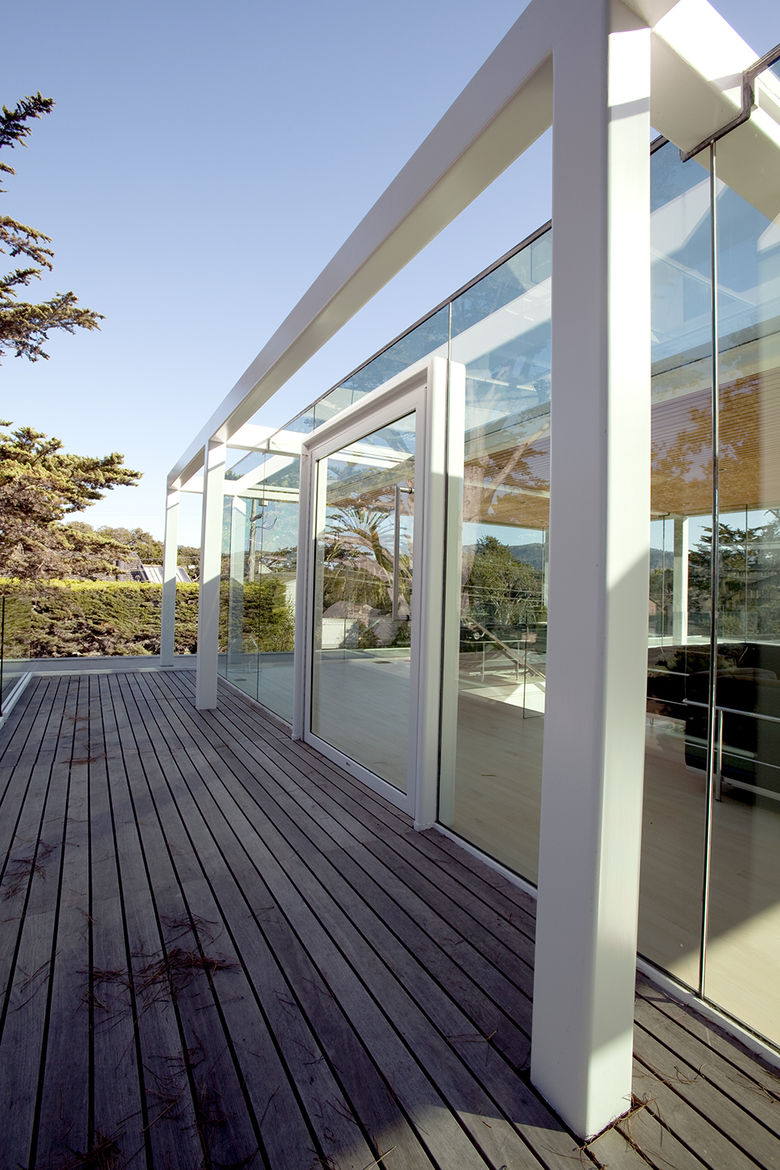 Custom steel door and ipe deck of pavilion atop Paley House by DYAR Architects and John Thodos in Carmel, California
