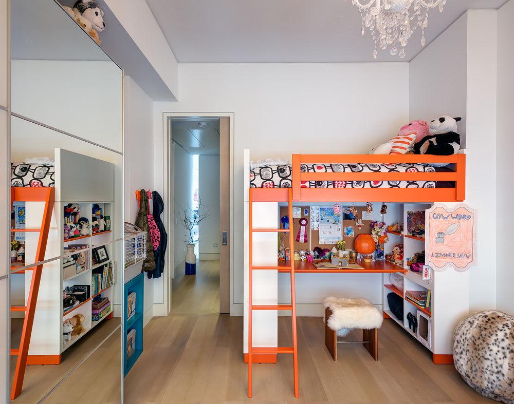 Kids' room with orange Ikea bunk beds