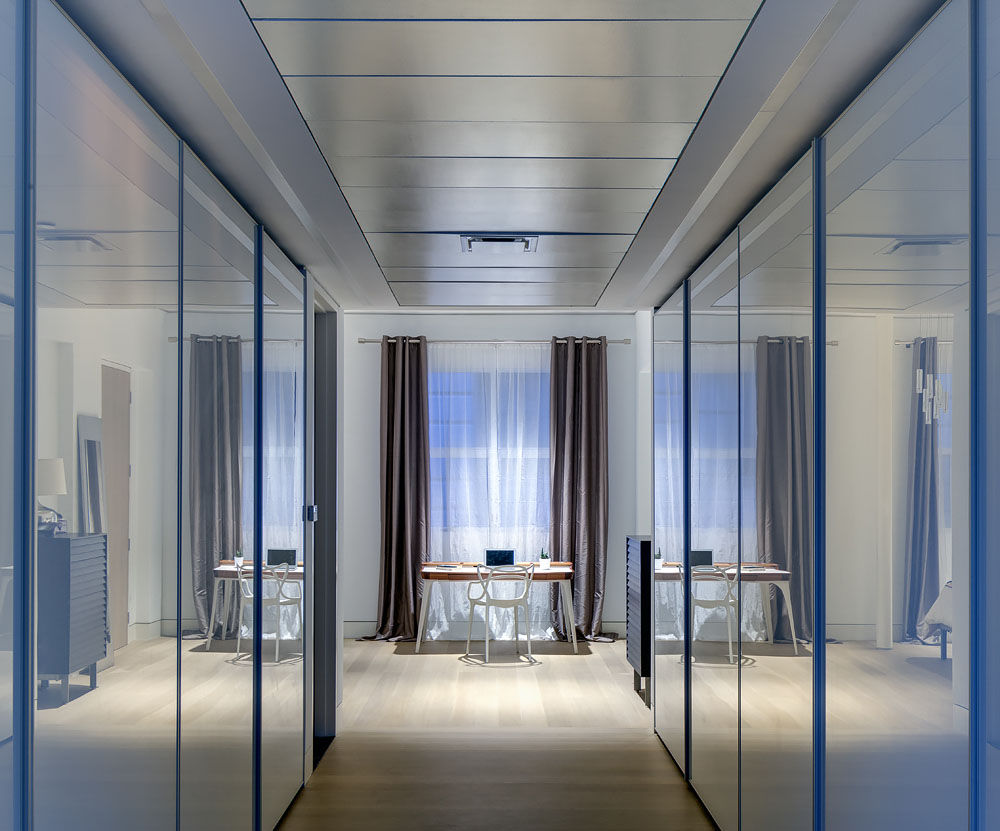 Reflective glass doors for a walk-in closet