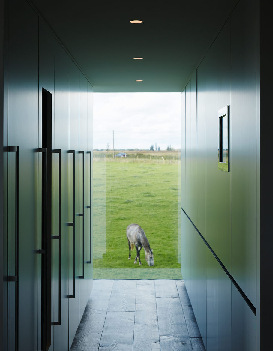 The home features views of the owner's horses.