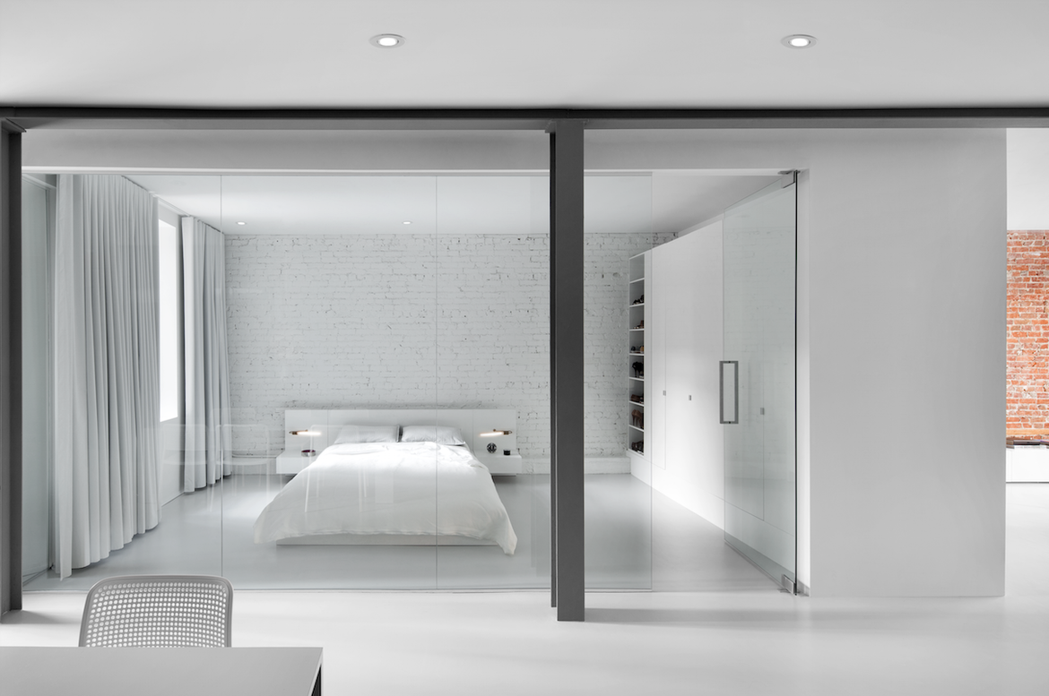 Glass-enclosed bedroom