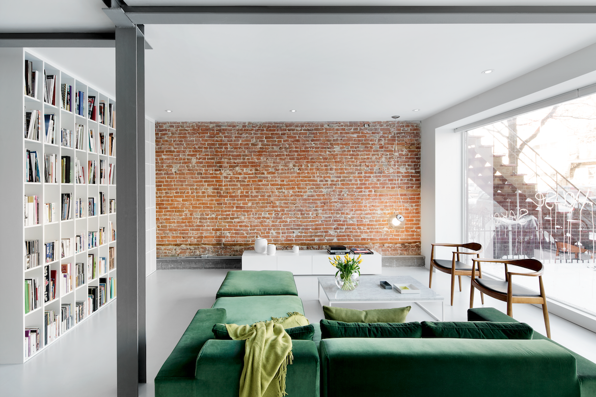 Montreal living room with exposed brick and a picture window