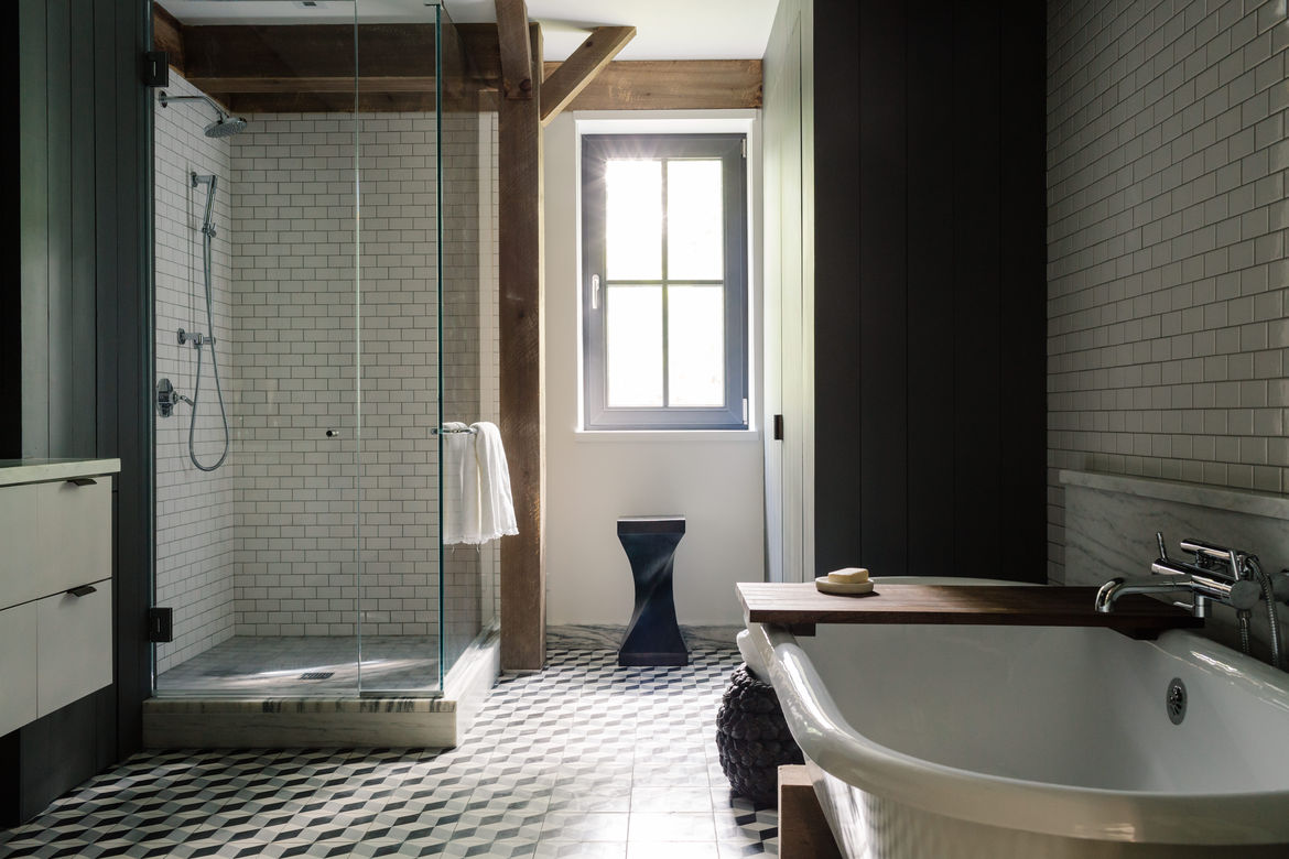 Tiles cover the master bathroom from floor to wall.
