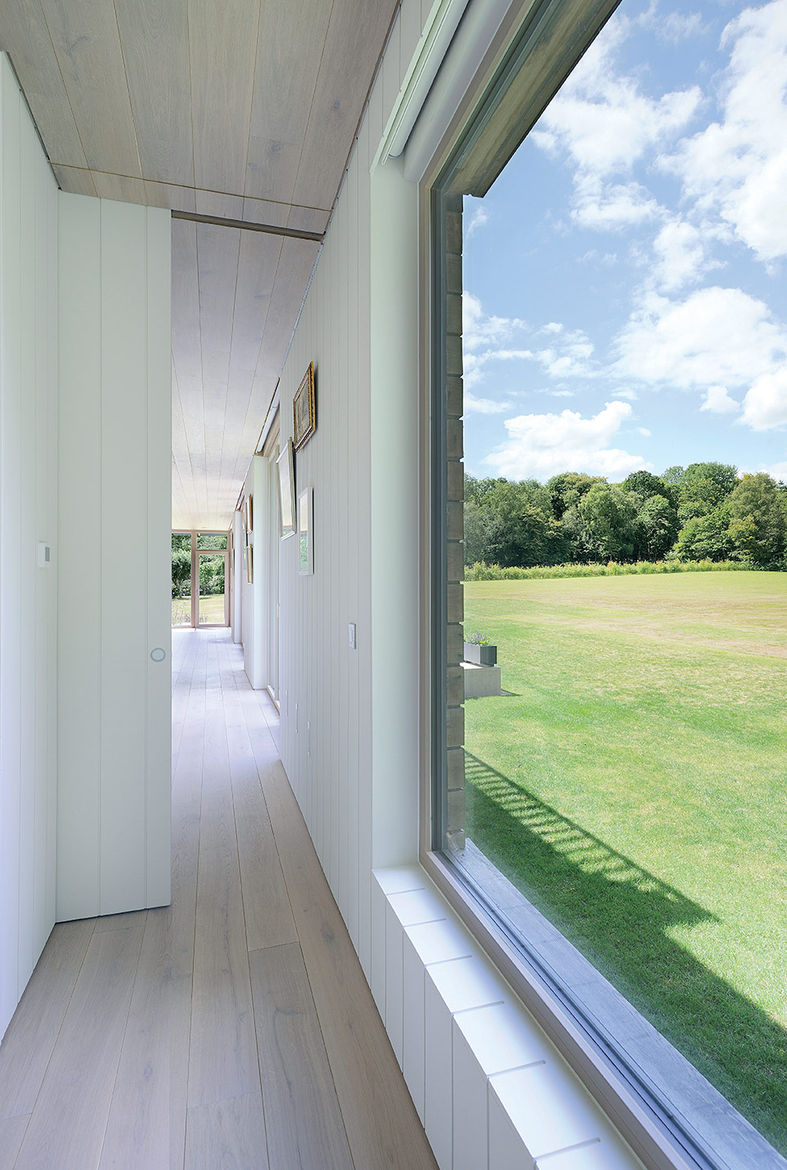 Modern prefab english mobile home with ecohaus internorm windows in the hallway