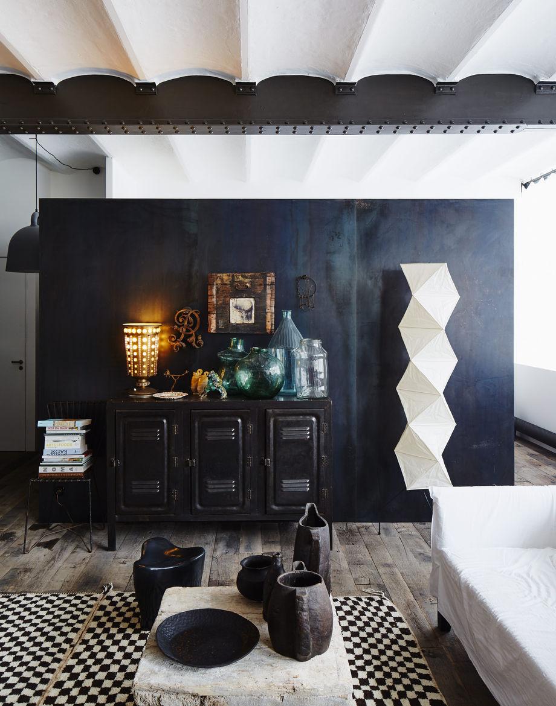 An oxidized metal partition divides this Paris apartment