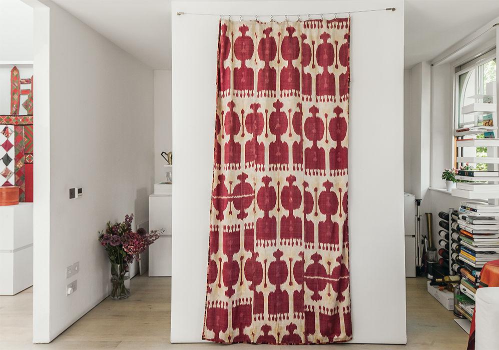 Tiny London apartment renovated kitchen entrances with textile