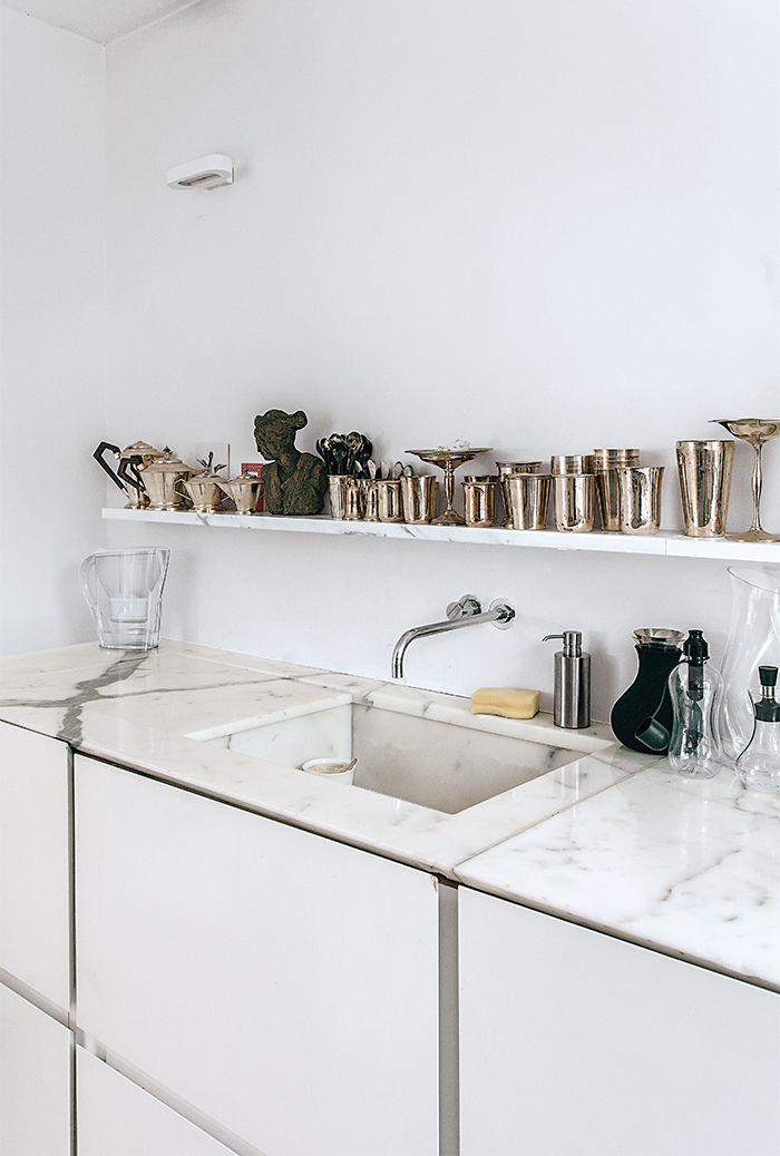 Tiny London apartment renovated kitchen with Vola faucet and marble countertop
