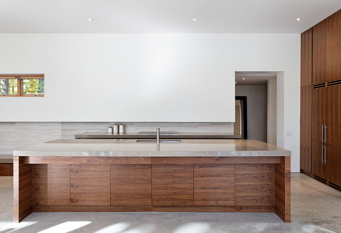 Minimalist kitchen with a wood and stone island in Ontario