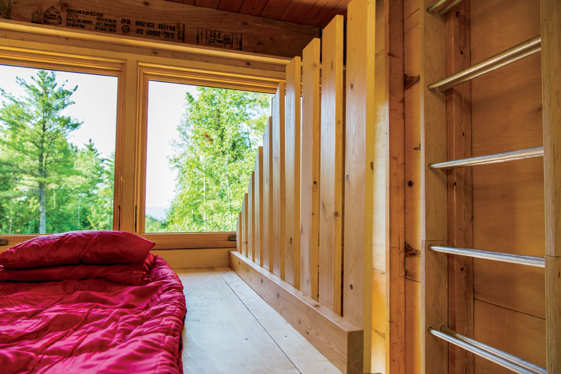 Ladder from sleeping area to roof deck in Wisconsin cabin by Revelations Architects/Builders.
