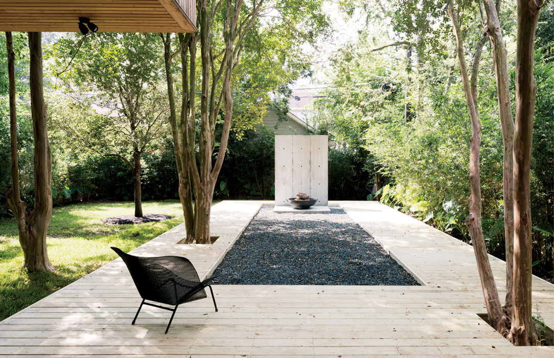 Modern Texas home with deck and metal grillage chairs by Francois Azambourg and Ligne Roset
