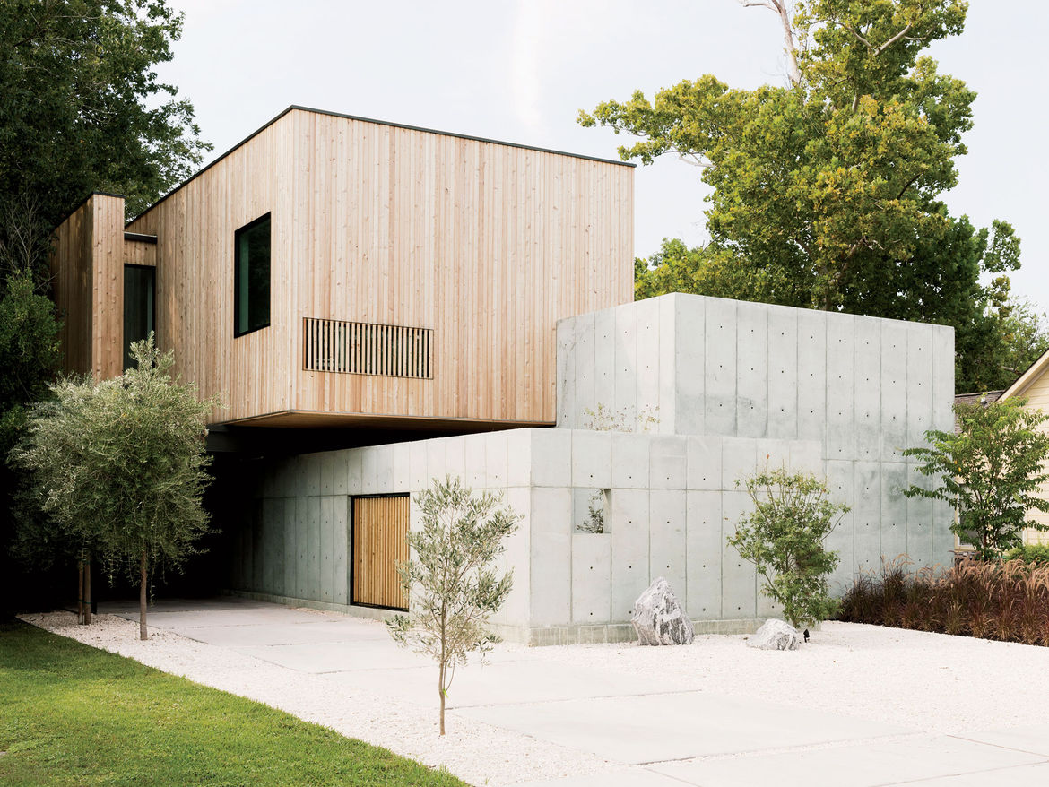 Modern Texas home facade with concrete walls and Siberian larch cladding